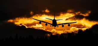 Airplane Silhouette on Air during Sunset · Free Stock Photo